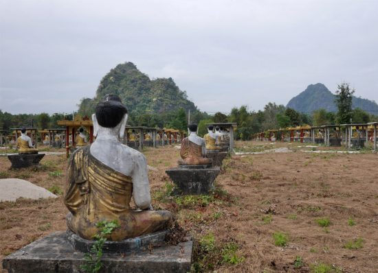 sitting buddhistic monks in hpa-an, myanmar